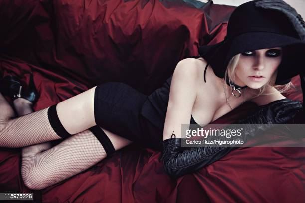 Actress Taylor Momsen is photographed for Madame Figaro on December 6 2011 in Paris France Published image Figaro ID 099422004 Body suit by Isabel...