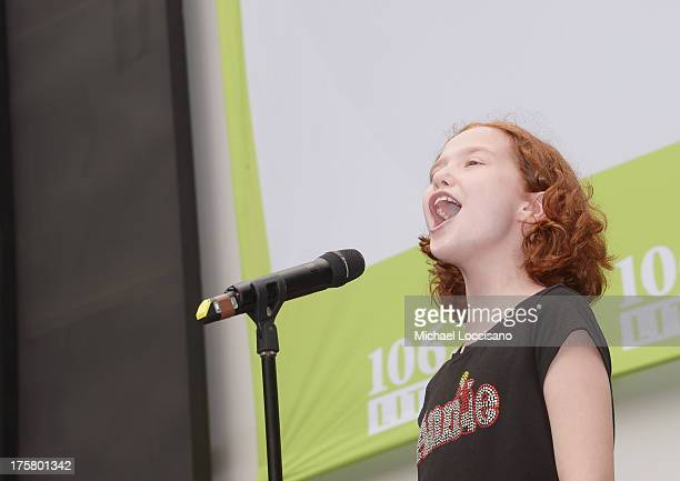 Actress Taylor Richardson of Annie performs during 1067 LITE FM's Broadway in Bryant Park 2013 at Bryant Park on August 8 2013 in New York City