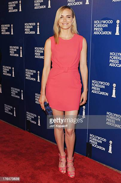 Actress Taylor Schilling arrives at the Hollywood Foreign Press Association's 2013 Installation Luncheon at The Beverly Hilton Hotel on August 13...