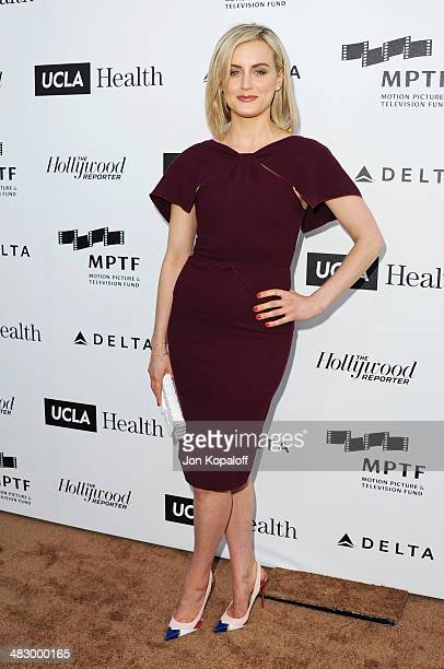 Actress Taylor Schilling arrives at the MPTF Reel Stories, Real Lives Event at Milk Studios on April 5, 2014 in Los Angeles, California.