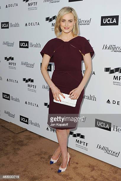 Actress Taylor Schilling arrives at the MPTF Reel Stories Real Lives Event at Milk Studios on April 5 2014 in Los Angeles California