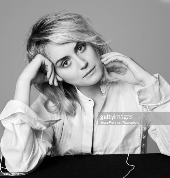 Actress Taylor Schilling is photographed for Madame Figaro on April 7 2017 in New York City Shirt earring body Makeup by Sisley PUBLISHED IMAGE...