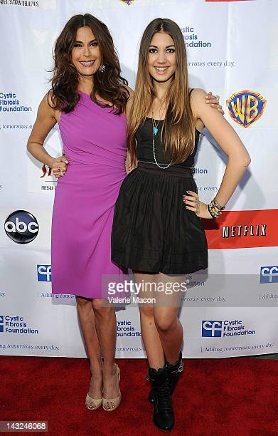 Actress Teri Hatcher and daughter Emerson attends 2nd Annual Wisteria Lane Block Party at Universal Studios Backlot on April 21 2012 in Universal...