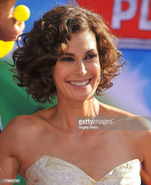 Actress Teri Hatcher arrives at the premiere of Disney's 'Planes' presented by Target at the El Capitan Theatre on August 5, 2013 in Hollywood,...