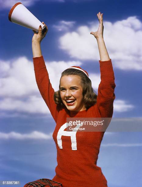 Actress Terry Moore as a cheerleader with megaphone Los Angeles California 1949