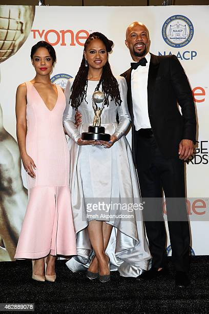 Actress Tessa Thompson director Ava DuVernay and actor Common pose in the press room during the 46th NAACP Image Awards presented by TV One at...