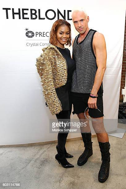 Actress Teyana Taylor poses for a photo with designer David Blond backstage at The Blonds fashion show during MADE Fashion Week September 2016 at...