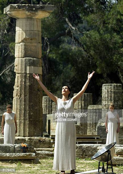 Actress Thalia Prokopiou acting as high priestess calls to the Greek ancient god Apollon in ancient Olympia the sanctuary where the Olympic Games...
