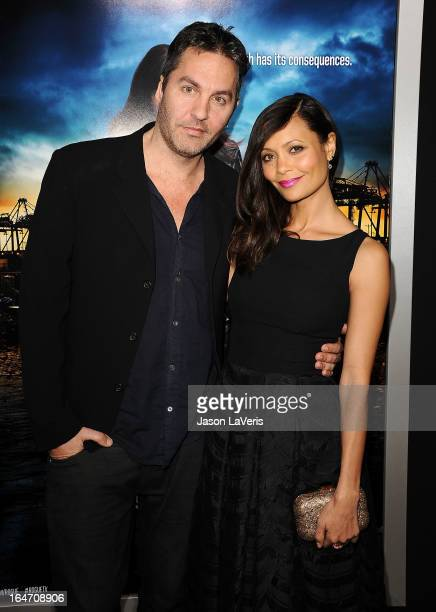 Actress Thandie Newton and husband Ol Parker attend the premiere of Rogue at ArcLight Hollywood on March 26 2013 in Hollywood California
