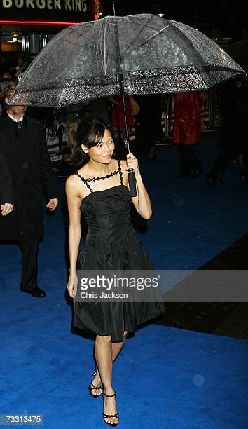 Actress Thandie Newton attempts to keep dry as she arrives at the World Premiere of Hot Fuzz held at the Vue West End on February 13 2007 in London...