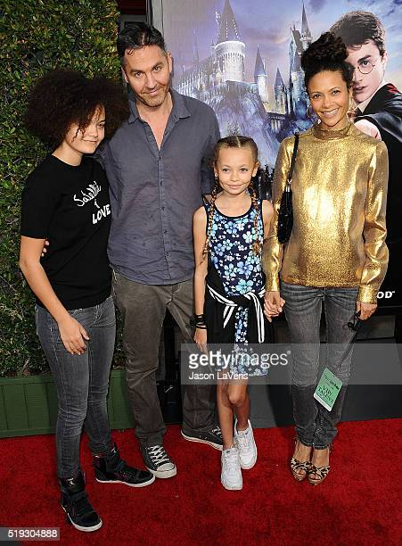 Actress Thandie Newton husband Ol Parker and children Ripley Parker and Nico Parker attend the opening of The Wizarding World of Harry Potter at...
