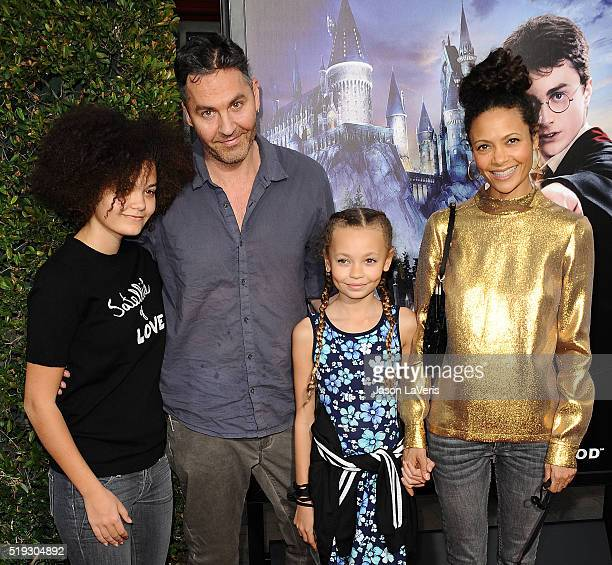 Actress Thandie Newton husband Ol Parker and children Ripley Parker and Nico Parker attend the opening of 'The Wizarding World of Harry Potter' at...
