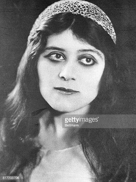 Actress Theda Bara in a close fitting crocheted cap