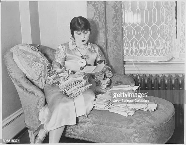 Actress Theda Bara Reading Fan Letters