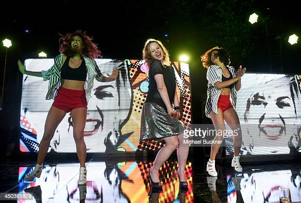 Actress Thora Birch dances onstage the TakeTwo E3 Kickoff Party at Cecconi's Restaurant on June 9 2014 in Los Angeles California