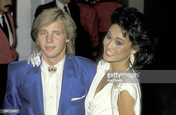 Actress Tia Carrere and Kenny Rogers Jr attend the 28th Annual Grammy Awards PreParty on February 23 1986 at Chasen's Restaurant in Beverly Hills...