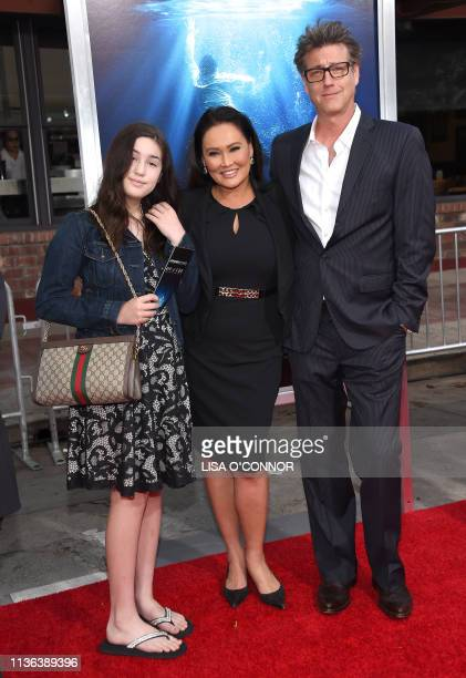 Actress Tia Carrere British photojournalist Simon Wakelin and their daughter Bianca Wakelin arrive for the 'Breakthrough' Los Angeles premiere at...