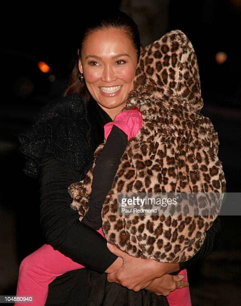Actress Tia Carrere holding daughter Bianca Wakelin arrives at Alliance For Children's Rights Hosts 3rd Annual Dinner With Friends on October 5 2010...