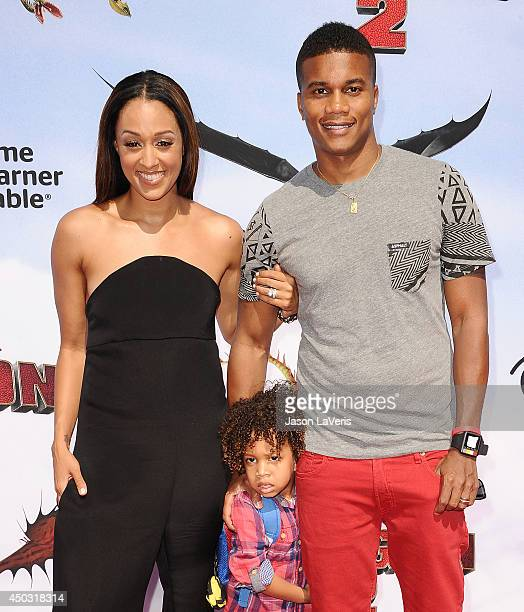 Actress Tia Mowry actor Cory Hardrict and son Cree Taylor Hardrict attend the premiere of 'How To Train Your Dragon 2' at Regency Village Theatre on...