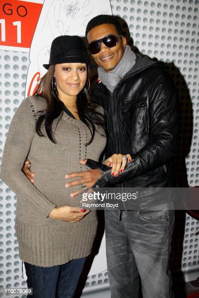 Actress Tia Mowry and her husband Cory Hardrict pose for photos in the WGCIFM 'CocaCola Lounge' in Chicago Illinois on MAR 11 2011