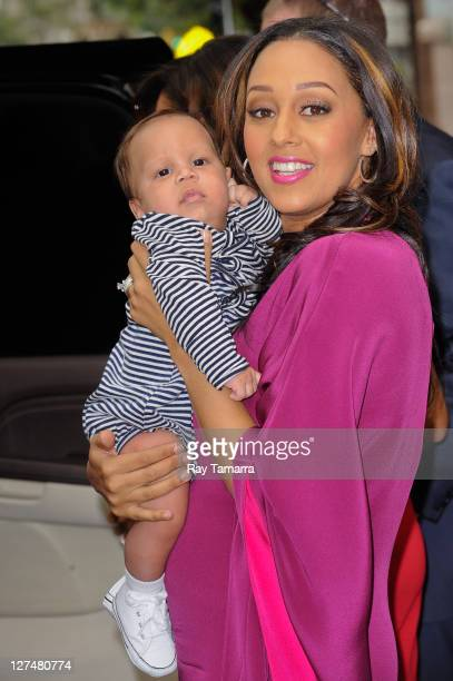 """Actress Tia Mowry and her son Cree Hardrict leave the """"Wendy Williams Show"""" taping at the AMV Studios on September 27, 2011 in New York City."""