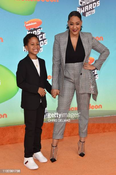 US actress Tia Mowry and son Cree Hardrict arrive for the 32nd Annual Nickelodeon Kids' Choice Awards at the USC Galen Center on March 23 2019 in Los...
