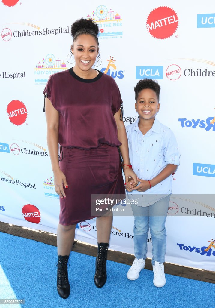 Actress Tia Mowry (L) attends the 18th annual Mattel Party On The Pier at Pacific Parkâ Santa Monica Pier on November 5, 2017 in Santa Monica, California