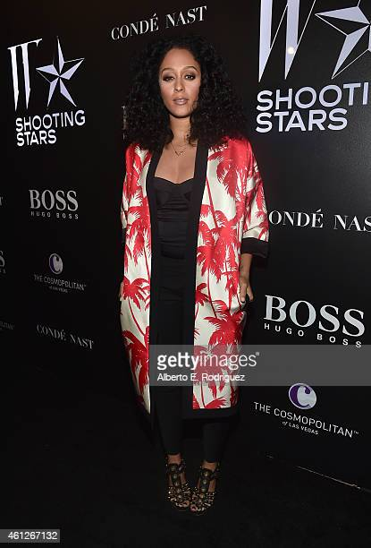 Actress Tia Mowry attends the W Magazine Shooting Stars Exhibit Opening at Wilshire May Company Building on January 9 2015 in Los Angeles California