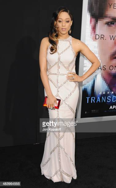 """Actress Tia Mowry-Hardrict arrives at the Los Angeles premiere """"Transcendence"""" at Regency Village Theatre on April 10, 2014 in Westwood, California."""