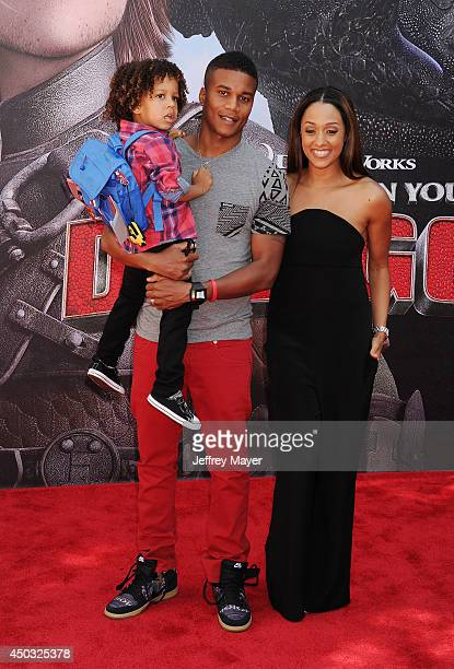 Actress Tia MowryHardrict husband Cory Hardrict and son Cree Taylor Hardrict arrive at the Los Angeles premiere of 'How To Train Your Dragon 2' at...