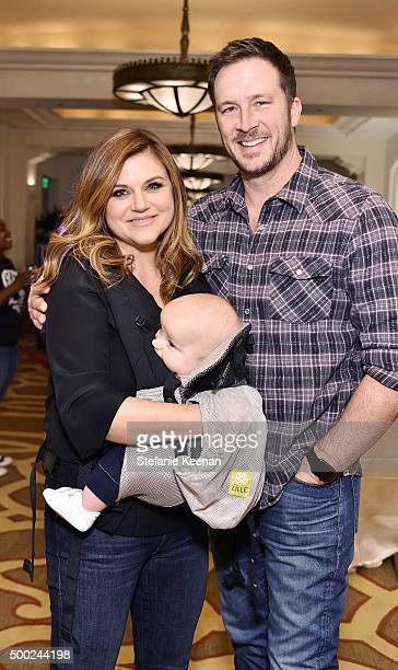 Actress Tiffani Amber Thiessen and Brady Smith attend the Baby2Baby Holiday Party Presented By Tiny Prints At Montage Beverly Hills on December 6...