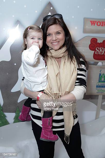 Actress Tiffani Amber Thiessen and daughter Harper Renn Smith attend the Working Elves' First Annual Santa's Secret Workshop Benefitting LA Family...