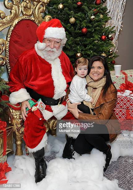 Actress Tiffani Amber Thiessen and daughter Harper Renn Smith pose with Santa at the Working Elves' First Annual Santa's Secret Workshop Benefitting...
