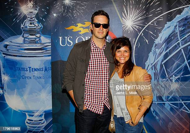 Actress Tiffani Amber Thiessen smiles alongside husband and actor Brady Smith while attending Day Eleven of the 2013 US Open at the USTA Billie Jean...