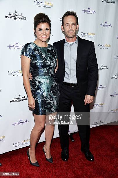 Actress Tiffani Thiessen and actor Luke Perry arrive at the Hallmark Channel's Holiday Christmas world premiere screening of Northpole at La Piazza...