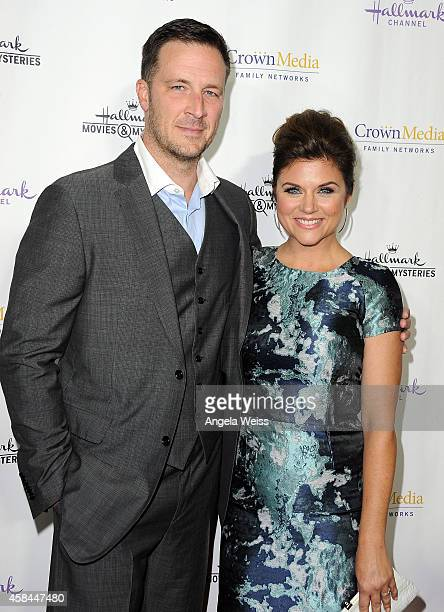 Actress Tiffani Thiessen and Brady Smith arrive at Hallmark Channel's annual holiday event premiere screening of Northpole at La Piazza Restaurant on...