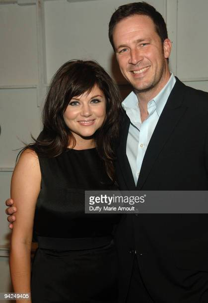 Actress Tiffani Thiessen and Brady Smith attend Thuy Spring 2010 during MercedesBenz Fashion Week at Bryant Park on September 13 2009 in New York City