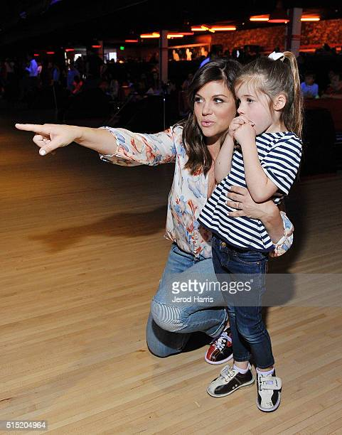 Actress Tiffani Thiessen and daughter Harper attend the Grand Opening of Bowlero on March 12 2016 in Woodland Hills California