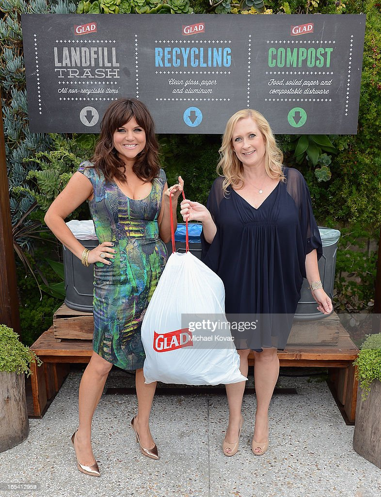 Actress Tiffani Thiessen and event planner Heidi Mayne of Red25 Events cinch up their one bag of trash from an eco-conscious, adults-night-out party they hosted with close friends at The Smog Shoppe on April 3, 2013 in Los Angeles, California. The party was sponsored by Glad as part of their One Bag campaign, which helps events of all sizes reduce their waste to just one bag of landfill trash, with the rest recycled or composted.