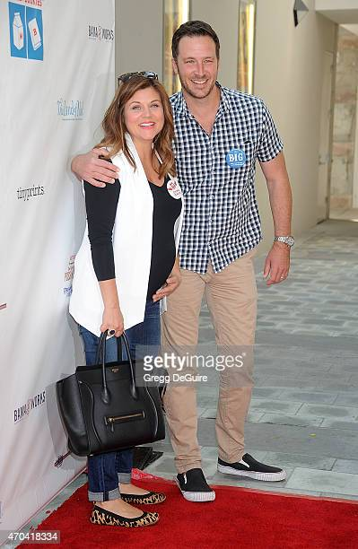 Actress Tiffani Thiessen and husband Brady Smith arrive at the Milk Bookies 6th Annual Story Time Celebration at Skirball Cultural Center on April 19...