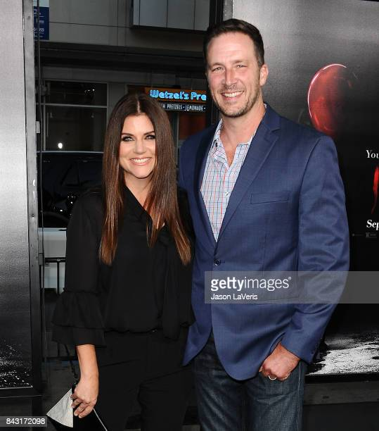 Actress Tiffani Thiessen and husband Brady Smith attend the premiere of It at TCL Chinese Theatre on September 5 2017 in Hollywood California