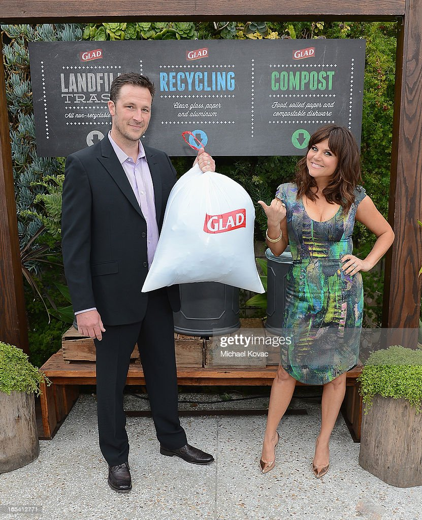 Actress Tiffani Thiessen and husband Brady Smith cinch up their one bag of trash from an eco-conscious, adults-night-out party they hosted with close friends at The Smog Shoppe on April 3, 2013 in Los Angeles, California. The party was sponsored by Glad as part of their One Bag campaign, which helps events of all sizes reduce their waste to just one bag of landfill trash, with the rest recycled or composted.