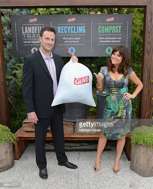 Actress Tiffani Thiessen and husband Brady Smith cinch up their one bag of trash from an ecoconscious adultsnightout party they hosted with close...