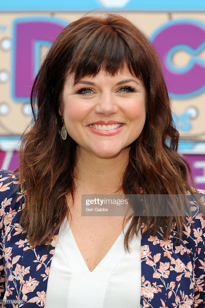 Actress Tiffani Thiessen attends the Doc Mobile Tour at the Disney Store on August 21, 2013 in New York City.