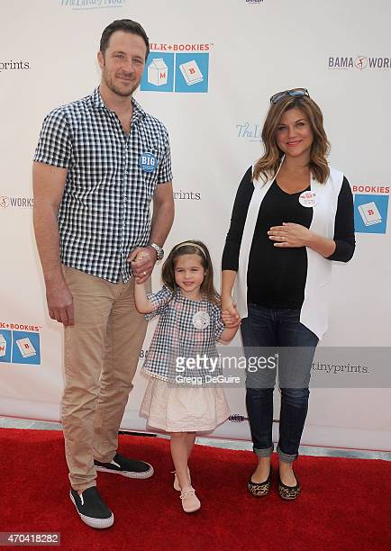 Actress Tiffani Thiessen husband Brady Smith and daughter Harper Renn Smith arrive at the Milk Bookies 6th Annual Story Time Celebration at Skirball...