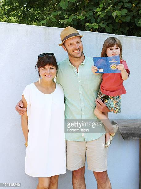 Actress Tiffani Thiessen husband Brady Smith and daugther Harper Smith attend Children's Museum Of The East End's 5th Annual Family Fair on July 20...