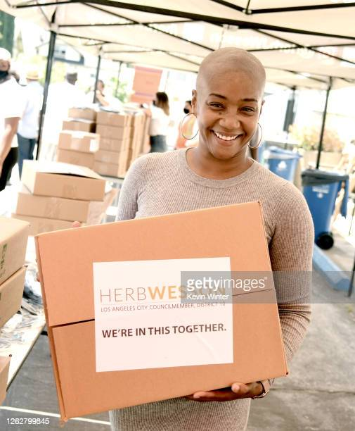Actress Tiffany Haddish helps donate Chromebook computers to students in foster care during a drivethru giveaway event at Wessons's district office...