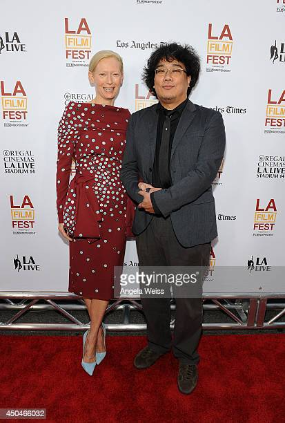 Actress Tilda Swinton and director Joonho Bong attend the opening night premiere of Snowpiercer during the 2014 Los Angeles Film Festival at Regal...