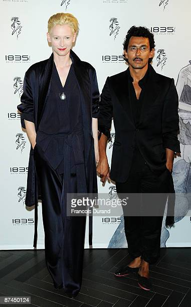 Actress Tilda Swinton and fashion designer Haider Ackermann arrives at the 1835 Hotel ReOpening Party at the 1835 Hotel during the 62nd International...