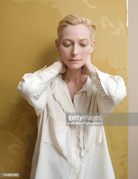 Actress Tilda Swinton poses at a portrait session for Madame Figaro Magazine in 2010 Silk shirt by Celine Hair by Marion Anee Makeup by Brigitte...